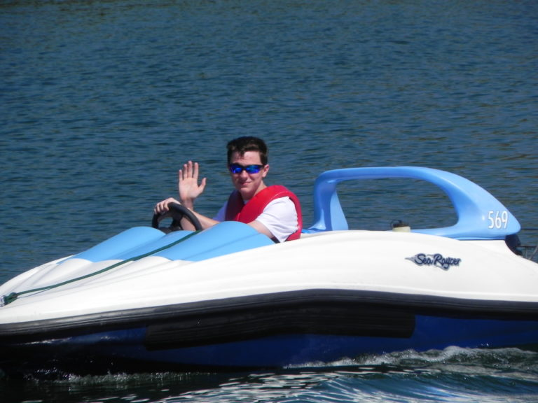 Aaron driving boat at Grand Floridian