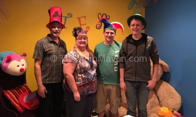 Family picture in the Mad Hatter Room at Escape Countdown Sarasota