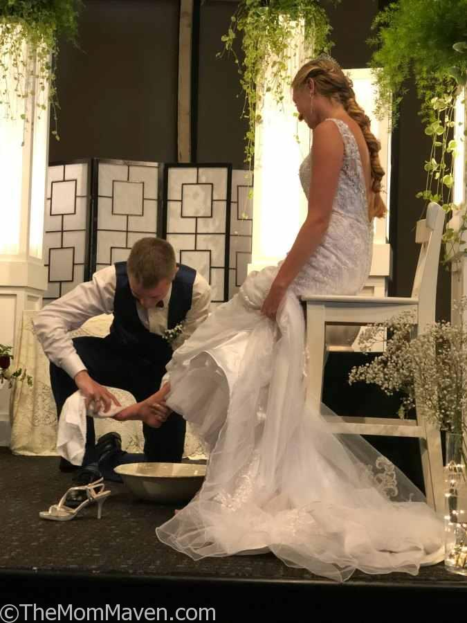 Foot washing during the wedding ceremony.