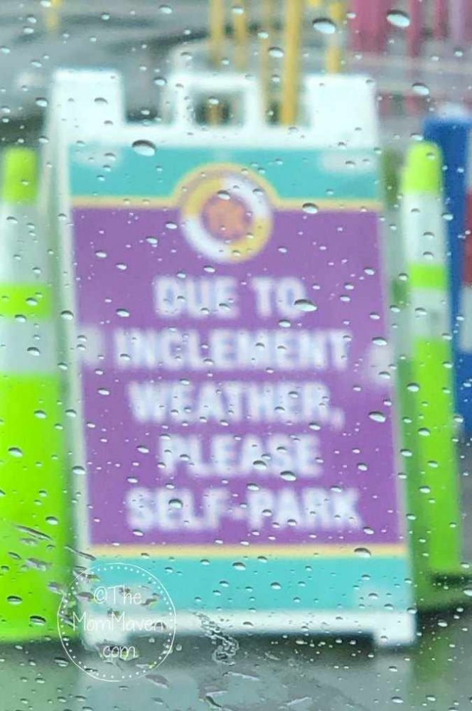 Rainy day at disney world parking sign-themommaven.com