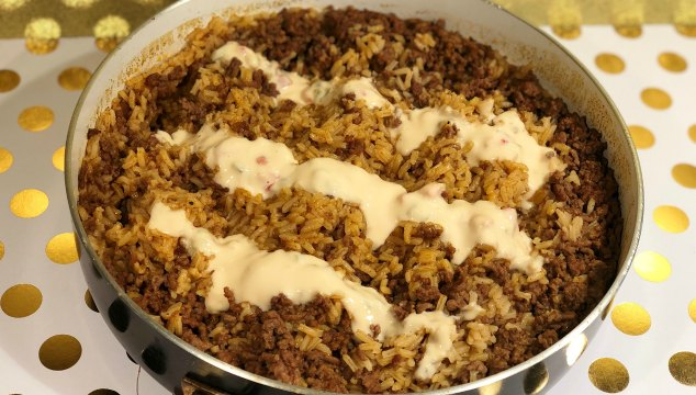 Taco Rice is a versatile dish brimming with Mexican flavor. It can be and entree, side dish, dip, or served on a taco bar!