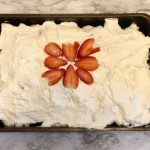 My simple strawberry ice box cake is made with layers of cookies, pudding, whipped cream and delicious Florida strawberries.