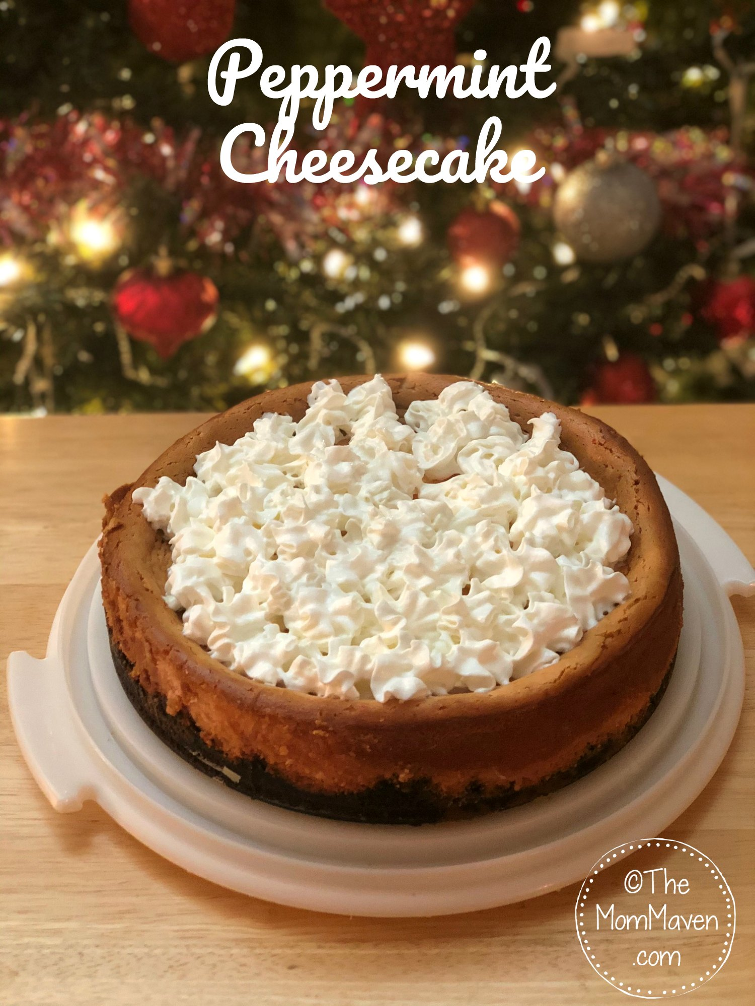 Perfect for any Christmas celebration, this Peppermint Cheesecake recipe has a chocolate graham cracker crust, crushed candy canes in the cheesecake layer, and is topped with whipped cream.