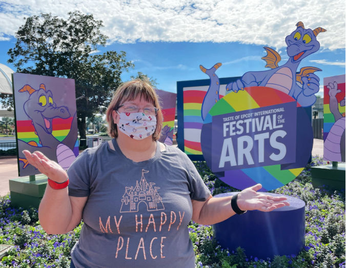 Cindy in front of the festival sign