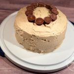 If you love chocolate and peanut butter together, you will love this Peanut Butter Cup Cake. It's Triple Chocolate Cake topped with Peanut Butter Cream Cheese Frosting filled and decorated with mini Reese's Peanut Butter Cups. Yum!